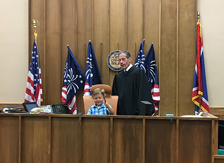 On Friday, August 3, Campbell County Health Trustee Alan Stuber was sworn in by Judge John Perry in Gillette, Wyoming. Judge Perry invited Stuber's son Brian to the bench to make it official.