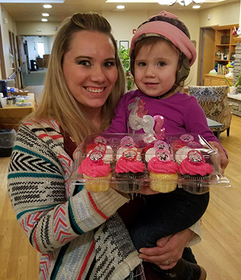 Leslie Engstrom of Hospice (and daughter, Harlee) brought by cupcakes for staff today as her random act of kindness